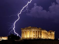 A flash of lightning illuminates the sky over the 2,500-year-old Ancient Parthenon temple, on the Acropolis hill during heavy rainfall in Athens, early Monday, June 28, 2010.AP Photo/Petros Giannakouris