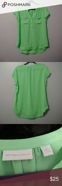 Lime green womens top Selling brand new sheer blouse with a couple buttons and v neck . Two pockets on the front and capped sleeves New York & Company Tops Blouses
