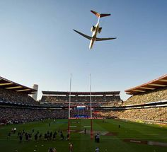 A plane flies over Ellis Park before the South Africa v New Zealand game