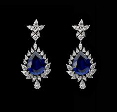 Add a fresh splash of colour with this #glamorous pair of #DiosabyDarshanDave #earrings. They feature blue stylized stone elegantly surrounded by pear-shaped #SwarovskiZiconia in minimal #SterlingSilver setting. They are perfect for any woman and any #occasion. Available on www.diosajewels.com #makeeverydaybrilliant #jewellery #finejewellery #traveljewellery #weddings #fashionwear #preciousjewellery #luxejewellery  #dailywear #workwear #casualwear #destinationweddings #bridalwear