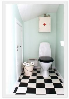 am SO looking for that medicine cabinet...like the enamel bucket with toilet roll in too