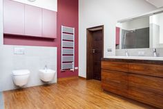 Spacious Bathroom With Wooden Floors Throughout