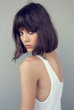 Blunt one length lob with bangs. Nice smokey eye too. Best to wear this cut a bit messy.