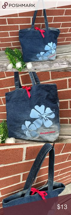 "Polo Jeans Company Denim tote good condition with little signs of wear. Embroidered branding name and embroidered floral design. Tie closure. Interior zipper and interior slot pockets interior key holder and interior sling coin pouch. 13""W x 13""L x 12""D 10"" strap drop. Polo by Ralph Lauren Bags Totes"