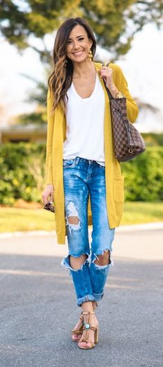Basic white tee, oversized mustard cardigan, distressed denim and strappy heels…