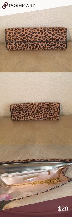 Super cute cheetah print clutch. Super cute cheetah print clutch.  In excellent condition.  Comes with beautiful gold chain if used as a shoulder purse. Aldo Bags Clutches & Wristlets