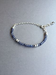 """Iolite Gemstone Bracelet, simple and dainty for everyday wear. This beauty is made up of dainty iolite beads intermixed with faceted pyrite and combined with sterling silver findings. Fits 7""""-7.5"""" ($38) #beadedbracelet #gemstonejewelry #gemstonebracelets"""