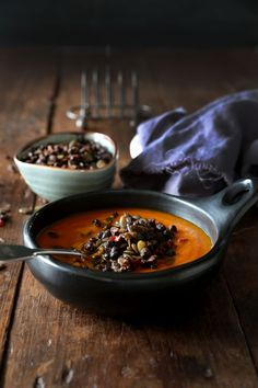 Carrot, Pumpkin and Turmeric Soup with Spicy Black Bean Topping by http://swoonfood.com