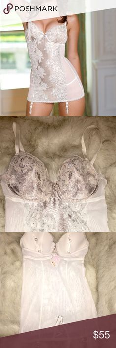 Victoria's Secret Sexy Rhinestone Lace Corset 36D Victoria's Secret Very Sexy Seduction Rhinestone Lace Corset w/ Garters 36D - NWT $88  Gorgeous limited edition nude and white lace rhinestone lingerie teddy. This sexy garter slip reflects full seduction and allure!   Size: 36D  Medium / Large  New w/ tag attached. Retail Price: $88.00  Chantilly Lace  Sparkly Silver Rhinestone Embellishment Underwire Cup Pads Adjustable Straps Adjustable Removable Garters Simply STUNNING!! Victoria's Secret…