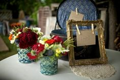 vintage, wallpapered can centerpieces  (photo credit: Jason+Gina Wedding Photographers)