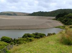 The dunes have blocked-up the original outlet for the stream, creating Lake Wainamu