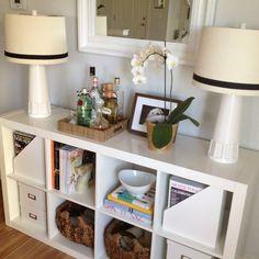 An IKEA bookshelf never looked so good. I like how a minibar is set on the top.