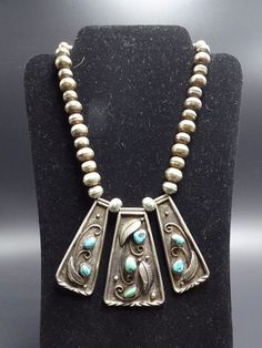 The pendants are adorned with three-dimensional applied leaves, scrolls, and raindrops, along with a total of seven specimens of high grade turquoise. The handmade Navajo pearls are hand-stamped with smooth edges. | eBay!