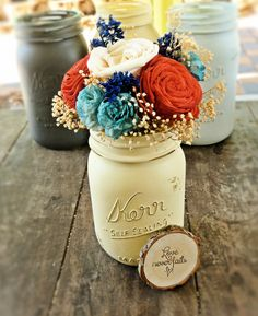 Can get a bunch of Mason jars at Walmart for cheap or anywhere and paint them and put flowers in for centerpieces