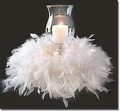 For the Christmas table - Hurricane Holder, Candle, White Boa against black table cloths.