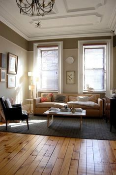 Look at the trim work on the ceiling.  Love the furniture too...