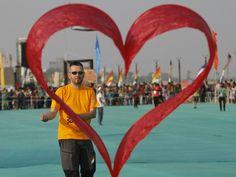 A kite flier from Switzerland flies his heart-shaped kite during the international kite festival in Ahmadabad, India, on Jan. 11, 2016.  Ajit Solanki, AP