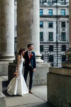 Modern, city cool, romantic, couple shot outside Bank, London    Styling by Nulyweds, Photo by Beatrici Photography, Dress by Sassi Holford, Flowers by Okishima & Simmonds