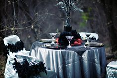 Halloween-inspired wedding table, but also would be a very elegant Halloween party display.