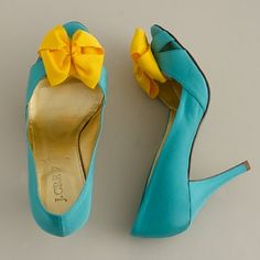 I dont excactly love the style of the shoes but i love the colors! tiffany blue with yellow bows wedding shoes