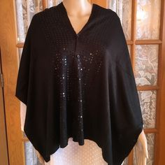 """Black Sequined Soft Acrylic Cape NWOT You can wear this do many different ways. It has 2 rows of buttons do you can wear the sequins down or across. You can wear this as a scarf too!! 16 1/2"""" X 62"""". Flawless. Non smoking home Simply Noelle Accessories Scarves & Wraps"""