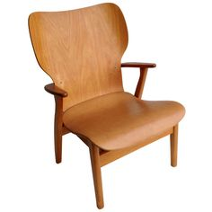 Ilmari Tapiovaara Domus leather and plywood armchair 1948 | From a unique collection of antique and modern armchairs at http://www.1stdibs.com/furniture/seating/armchairs/