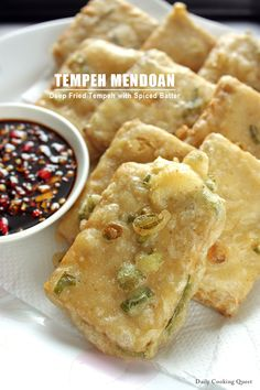 Tempeh Mendoan - Deep Friend Tempeh with Spiced Batter: Originated from the city of Purwokerto in Central Java, tempeh mendoan is a very popular street food, and for good reason. Unlike other tempeh dish, tempeh mendoan has a spiced batter coating. This coating, when deep fried, will be extra crispy yet the tempeh inside is still soft and tender, …