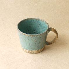 Japanese ceramic mug. Contrasting glaze colors and glaze behaviours.