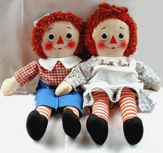 1970's Raggedy Ann & Andy dolls by Knickerbocker Toy Co. Love the fabric with little pink flowers.