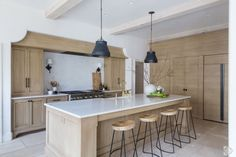 Gorgeous minimal and neutral kitchen with light natural wood cabinets - Dana Wolter