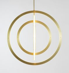 Halo Vertical Chandelier - 4 Rings (Brushed brass). Designed by Paul Loebach for Roll & Hill