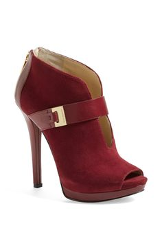Love this red hot Michael Kors peep toe bootie!