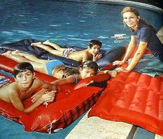 Family go for a swim, 1970s.