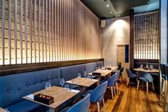 Anzu restaurant by Blenheim Design London England: Accent Wall uses play of cove lighting and material texture.