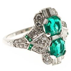 Art Deco  Emerald Diamond Platinum Ring. World class Art Deco ring. All original circa 1930 with top gem bright green Emeralds natural color low level clarity enhancement. Stamped with a serial number but no visible maker's mark.