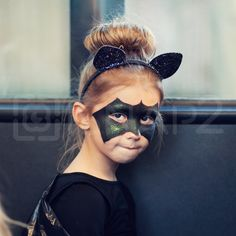 Playtime. Preparing for Halloween.  #iSnap2 #mobile #photography #mobilography #authentic #people #girl #costume #facepainting #fun #batgirl #halloween #outdoors #trickortreat #realpeople #colorphotography