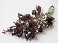 Check out this item in my Etsy shop https://www.etsy.com/uk/listing/482070341/purple-bag-charm-plum-bag-charm-teardrop