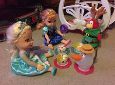 Dec 4 : day 1 our Christmas elf Sven hanging out with Queen Elsa and Princess Anna at a tea party drinking Olaf tea?!