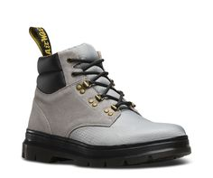 Influenced by 90's street wear and in a fusion of colors, the sporty, hiker-inspired Rakim boot features a padded contrast ankle, premium waterproof suede upper and nylon toe. They still retain the rebellious spirit stitched into every pair of Dr. Martens boots but in a more rugged, casual version. The boots are finished with 3 D-ring and 2 traditional eyelets for lacing, and our classic Dr. Martens branded heel-loop. Tough construction and outsole complete this utilitarian offering.