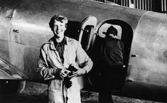 #AmeliaEarhart in 1937 in front of her Lockheed Electra, Fred Noonan stepping into the plane