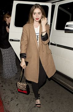 Lily Collins in Brown Trench Coat, White Printed Tee and Black Strap Sandals
