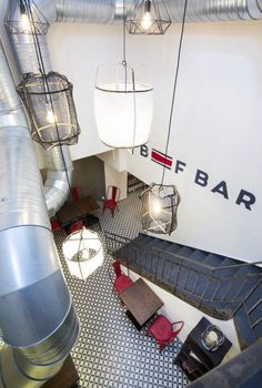 Ay Illuminate hanging lamps from Le Patio and an original staircase from 1910.