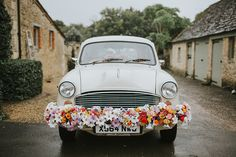 Indian Ambassador Car Transport Flowers Colourful Quirky Down To Earth Wedding http://jenmarino.com/