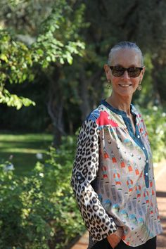 OthersideTunicMar. Linda V. Wright. She has a travel/fashion blog and is on fb. I love her style.