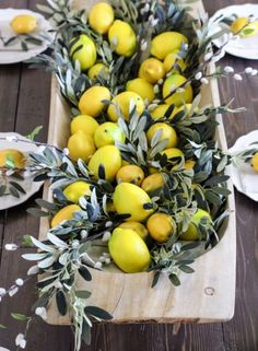 a dough bowl with willow pussy branches and lemons for tropical or summer wedding #delicious #fruit #wedding #centerpieces