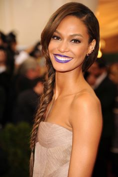 An extralong side braid and an electric bluish-purple lipstick set Joan apart from all the other minimal makeup looks of the night.