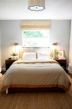 Love this for my bedroom! -brass bedside lighting -slider window -bamboo shades -light blue walls