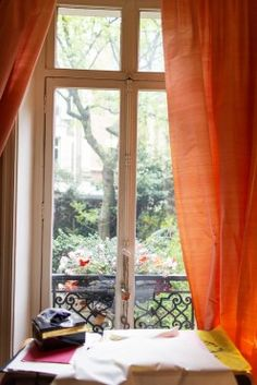 Marie Beltrami at Home in Paris « the selby Bright Curtains, Orange Curtains, Night Window, World Of Interiors, French Interiors, Through The Window, Home Decor Styles, Wall Colors, Living Spaces