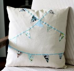 how to make a bunting pillow cover--Make one to accent the top of the fabric shelf in the sewing room.
