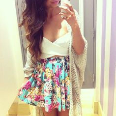 Criss-cross white bustier and a floral skirt.